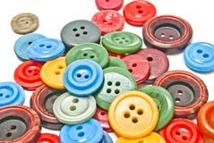 Colorful clothing buttons. Many colorful clothing buttons on white closeup Stock Images