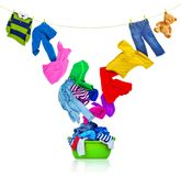 Colorful clothing flies out of the laundry bowl royalty free stock photography