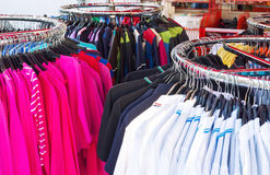 Colorful clothing on hangers Stock Image
