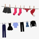 Colorful clothing hung by old wooden pegs Stock Image