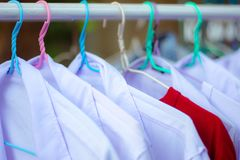 These cloths are hanging on the cloth line royalty free stock image