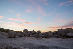 Colorful cloud formations at sunset. With rocks in the foreground Royalty Free Stock Photography