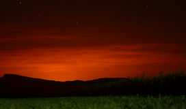 Colorful Clouds at Dawn. A night long exposure photography with sky, stars, nature and montains Stock Photography