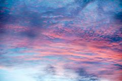 Colorful clouds with different shapes like a painting`s brush strokes royalty free stock image