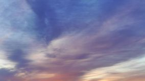 Impressive sky with colorful clouds flow during sunrise. Time lapse stock video footage