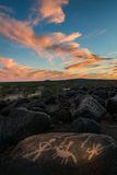 Colorful Clouds and Native American Rock Carvings Royalty Free Stock Image