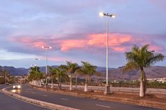 Colorful clouds over arid landscape of Gran Canaria royalty free stock image