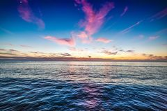 Colorful clouds over Pacific Beach shore Royalty Free Stock Image