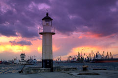 Colorful sky over the port and lighthouse. Moored vessels in the port.Photo taken on sunset at Varna port, Bulgaria, Europe on December,2013 stock photography