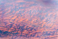 Colorful clouds in the sky with bright pinks over outback Australia, like a painting stock image
