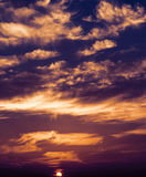 Colorful clouds and sun. Royalty Free Stock Photography