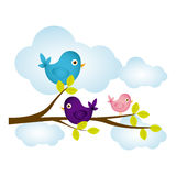 Colorful cloudscape with birds on branch with leaves Royalty Free Stock Image