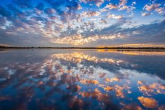 A colorful cloudy on sky is reflecting on water. A colorful of cloudy on sky is reflecting on water at sunrise timing located Loei province north east of stock photo