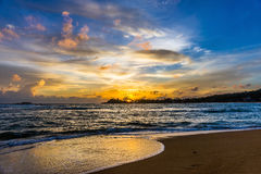 Colorful cloudy sunset sky over beautiful tropical beach Stock Photo