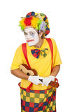 Colorful clown with ukulele Royalty Free Stock Photo