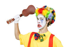 Colorful clown with ukulele Stock Images