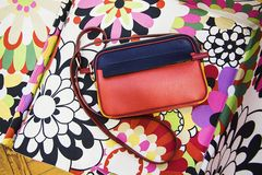 Colorful clutch. Clutch bag  on multicolor background Royalty Free Stock Photo