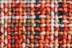 Colorful coarse woven cloth. Macro of a colorful coarse woven cloth with earthy colors stock image