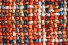 Colorful coarse woven cloth. Macro of a colorful coarse woven cloth with earthy colors stock photography