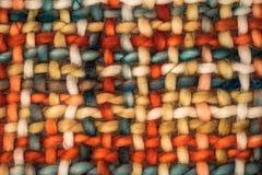 Colorful coarse woven cloth. Macro of a colorful coarse woven cloth with earthy colors royalty free stock photo