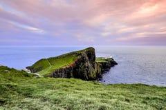 Colorful coastal sunset at Neist Point Lighthouse on Isle of Skye in Scotland, United Kingdom stock photos