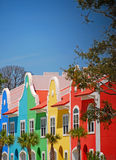 Colorful Coastal Townhomes. Row of bright multicolored coastal townhomes with palm trees out front Royalty Free Stock Photography