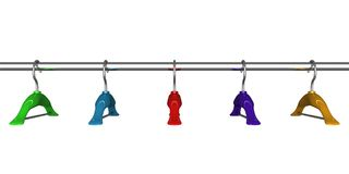 Colorful coat hangers on a clothes rail close up Royalty Free Stock Photography
