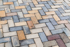 Colorful cobblestone road pavement Royalty Free Stock Photos