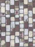 Colorful cobblestone road pavement. Royalty Free Stock Photos