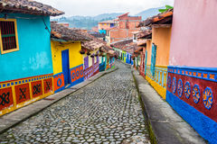 Colorful Cobblestone Street. Colorful colonial houses on a cobblestone street in Guatape, Antioquia in Colombia stock photos