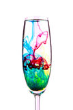 Colorful Cocktail. A champagne glass with swirling coloured cocktail Royalty Free Stock Photography