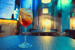 Colorful cocktail in glass with orange and lemon Royalty Free Stock Photos