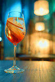 Colorful cocktail in glass with orange and lemon Stock Photos