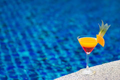 Colorful cocktail with orange by the pool Stock Photo