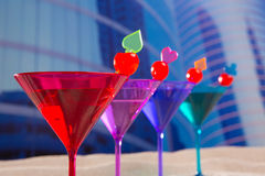 Colorful cocktail in a row with cherry sand in urban city Royalty Free Stock Photo