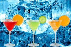 Colorful cocktails. With a ice cold background royalty free stock photography