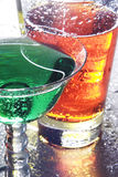 Colorful cocktails. Close up of two colorful drinks on a reflective tabletop stock photography