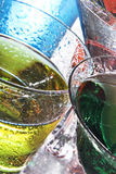 Colorful cocktails. Colorful wet drinks on a reflective tabletop royalty free stock images