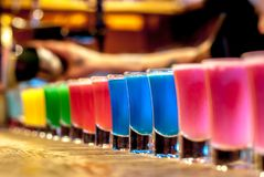 Colorful cocktails. On a bar stand stock photo