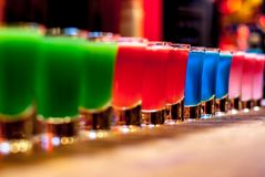 Colorful cocktails. On a bar stand royalty free stock image