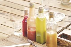 Colorful cocktails bottles. On bar stock photo
