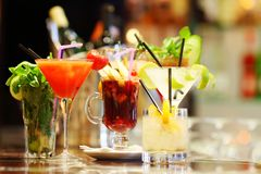 Colorful cocktails. Close up on bartend royalty free stock photos
