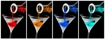 Colorful cocktails in frosty martini glasses Stock Photography