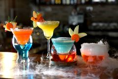 Colorful cocktails on the table. Colorful cocktails on the table in restaurant stock photography