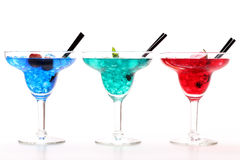 Colorful cocktails on white background. Three cups with colorful cocktails on white background stock photos