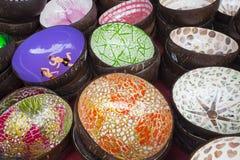 Colorful coconut shell bowls. Souvenir stock photo