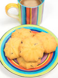 Colorful coffee cup with saucer and cookies Royalty Free Stock Photos
