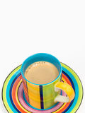 Colorful coffee cup with saucer Stock Images
