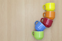 Colorful coffee cup on wood background. Stock Images