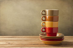 Colorful coffee cups and plates Stock Images
